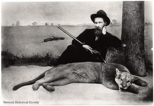 Alexander Crowell poses with a catamount, or mountain lion, that he shot and killed in November 1881. It proved to be the last sighting of the species in Vermont.