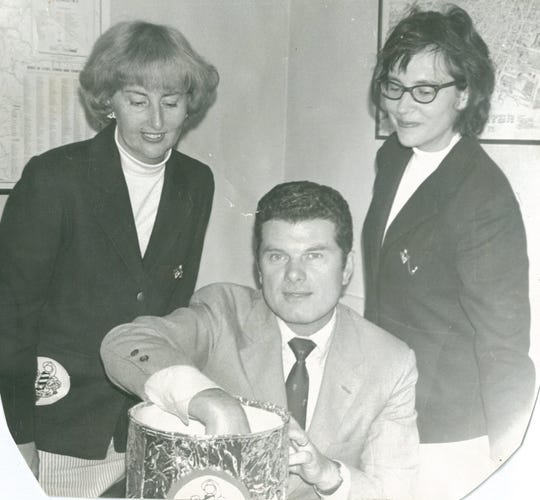 A 1969 photo shows Burlington Mayor Francis J. Cain drawing the order of appearances at a Harmony Inc. Convention and Competition hosted by the Champlain Echoes. He is seen with Shirley Lonegran, left, and Lyn Perrin.