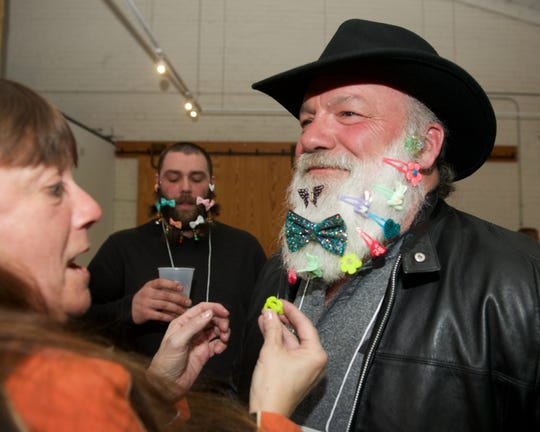 Vermont Beardies contestant Mike Burnham prepares for the decorated-beard portion of the competition held March 16 at ArtsRiot in Burlington.