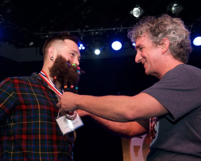 Steve Reilly of Bristol receives his prize for best beard Saturday from Make-A-Wish Vermont President/CEO James Hathaway at the third-annual Vermont Beardies held at ArtsRiot in Burlington.