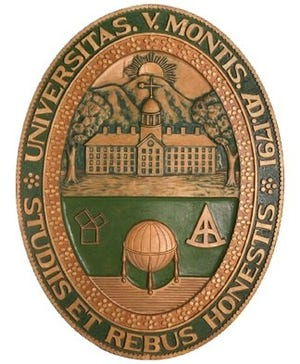 The former University of Vermont school seal in an undated photograph from the university. It was carved by Geno B. Lucarini. Professor Harry Perkins, who served as University Marshal, commissioned the work.