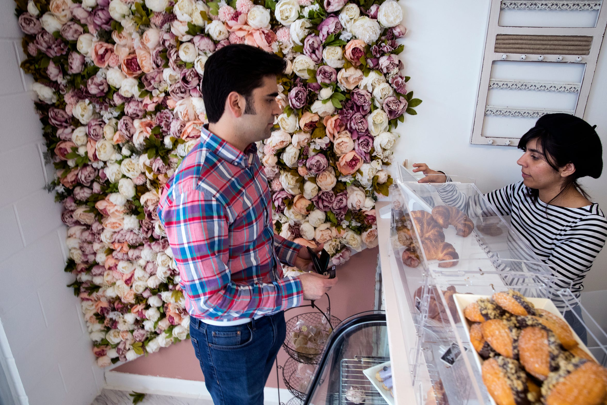 Jacob Crain (left) orders from Sadie Lopez, an employee with Bien Merite Chocolate and Bakery, on Friday, March 15, 2019. It is a new French bakery on South Staples Street that features pastries and chocolates that are made with whole ingredients and interesting combinations. They are also known for their macha and coffees.