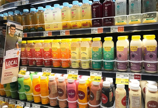 Origin Almond cold-pressed juices are offered in a refrigerator case at a Wynwood, Pa., Whole Foods. Locally, you can find Origin products at Whole Foods and Mom's Organic in South Jersey.