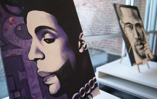 Paintings of Prince and Malcolm X by Willingboro artist Kenneth Moertl, known as Blazin Asian, are on display as part of an art exhibit at the Kennedy Center in Willingboro.