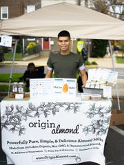 Jacob Deleon, founder of Origin Almond, selling his original almond milks at the Collingswood Farmers Market.