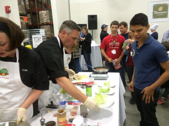 Origin Almond founder Jacob Deleon mentors Soulfull Project team members during the Food Bank of South Jersey's 2016 Hunger Games cooking competition. Now, Deleon's company is being mentored by Kraft/Heinz corporation to help grow the startup.