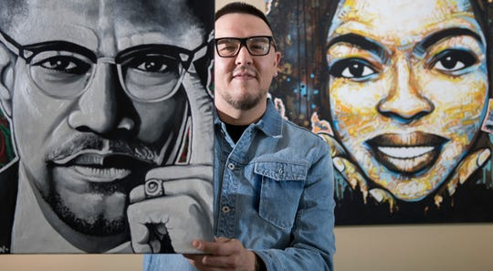 Willingboro artist Kenneth Moertl, known as Blazin Asian, stands with some of his art work that is on display as part of an art exhibit at the Kennedy Center in Willingboro.