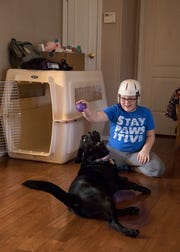 Andrew enjoys teaching Loretta new tricks like shake, roll over and dance. He says her favorite toy is a purple ball.