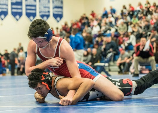 Zane Trace senior Alex Brown received his 100th career win against Logan Elm's Andrew Burns during the 2019 Division II sectional tournament in February of 2019.