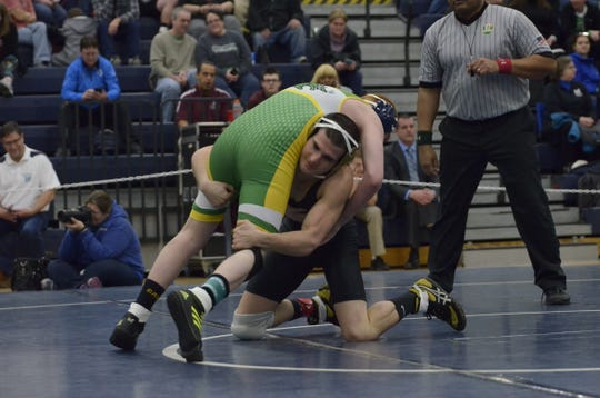 Paint Valley senior Adrian Salomone received his 100th career win while wrestling against West Union's Chad Long during his first-round match during Division III sectionals at Blanchester high school.
