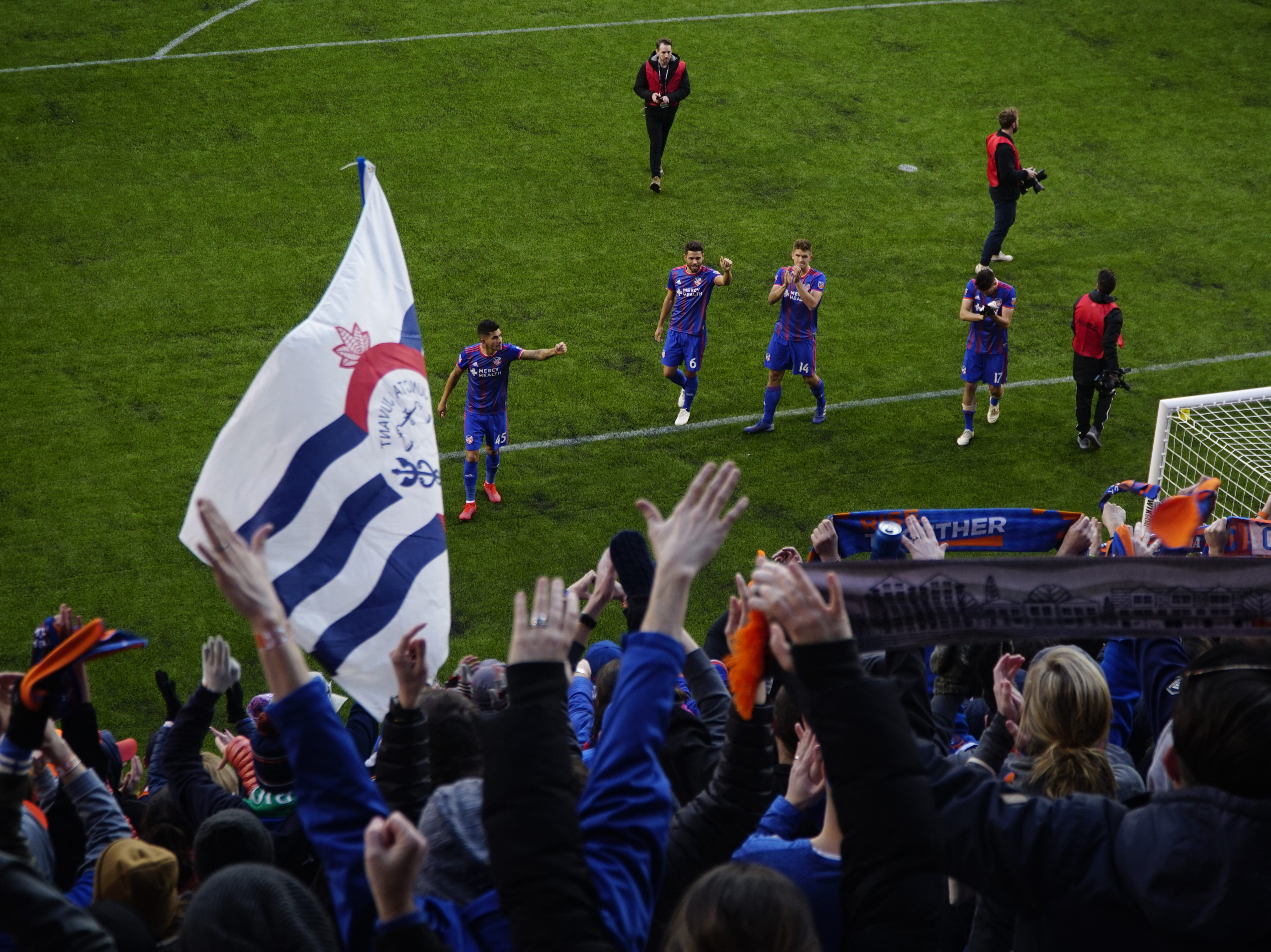 FC Cincinnati players wave to their fan section after winning their home opener against Portland at Nippert Stadium, March 17, 2019.