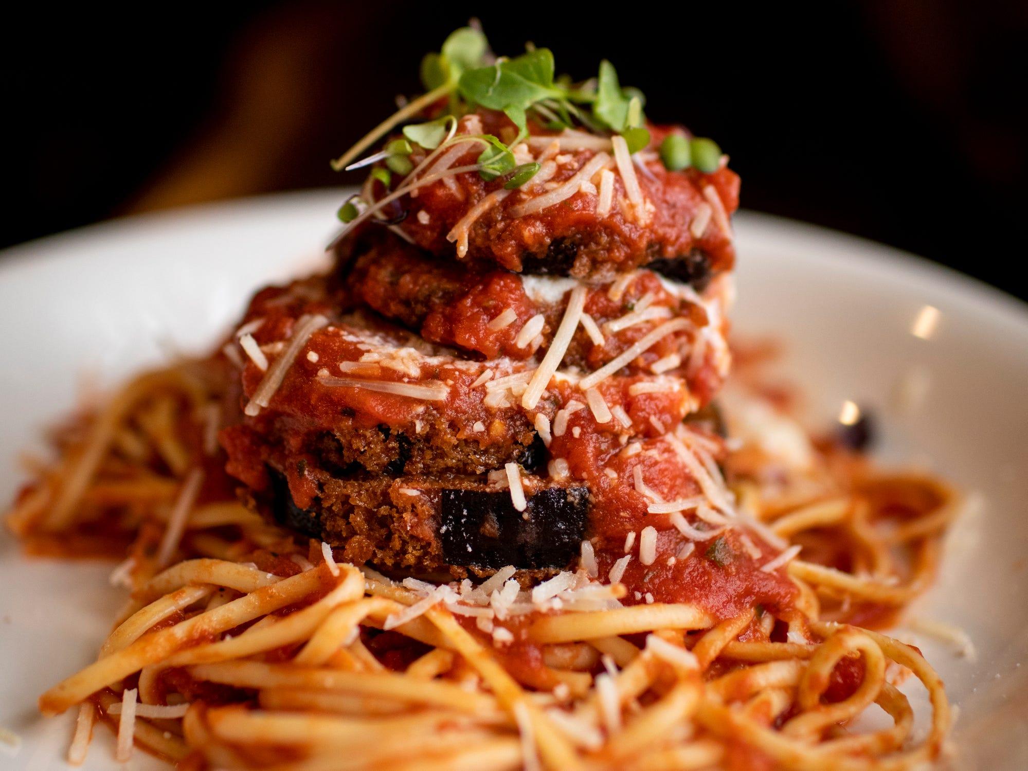 Sorrento's Italian Joint's eggplant parmesan is served atop al dente linguine and homemade marinara.