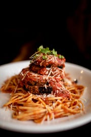 Sorrento's Italian Joint's eggplant parmesan is served atop al dente linguine and homemade marinara.