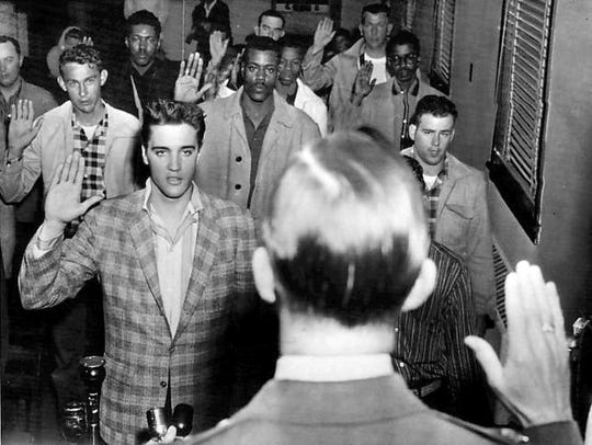 Elvis Presley being sworn into the U.S. Army at Fort Chaffee, Arkansas, March 24, 1958.