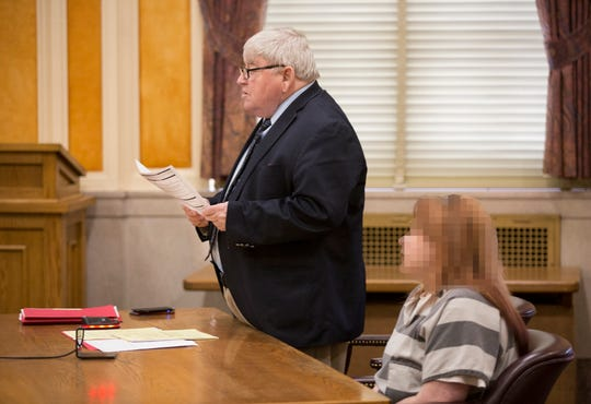 Local Portsmouth attorney, Michael Mearan, 73, with his client in the courtroom of Common Pleas Judge Mark Kuhn during a sentencing hearing in Scioto County Courthouse, in Portsmouth, Ohio.
