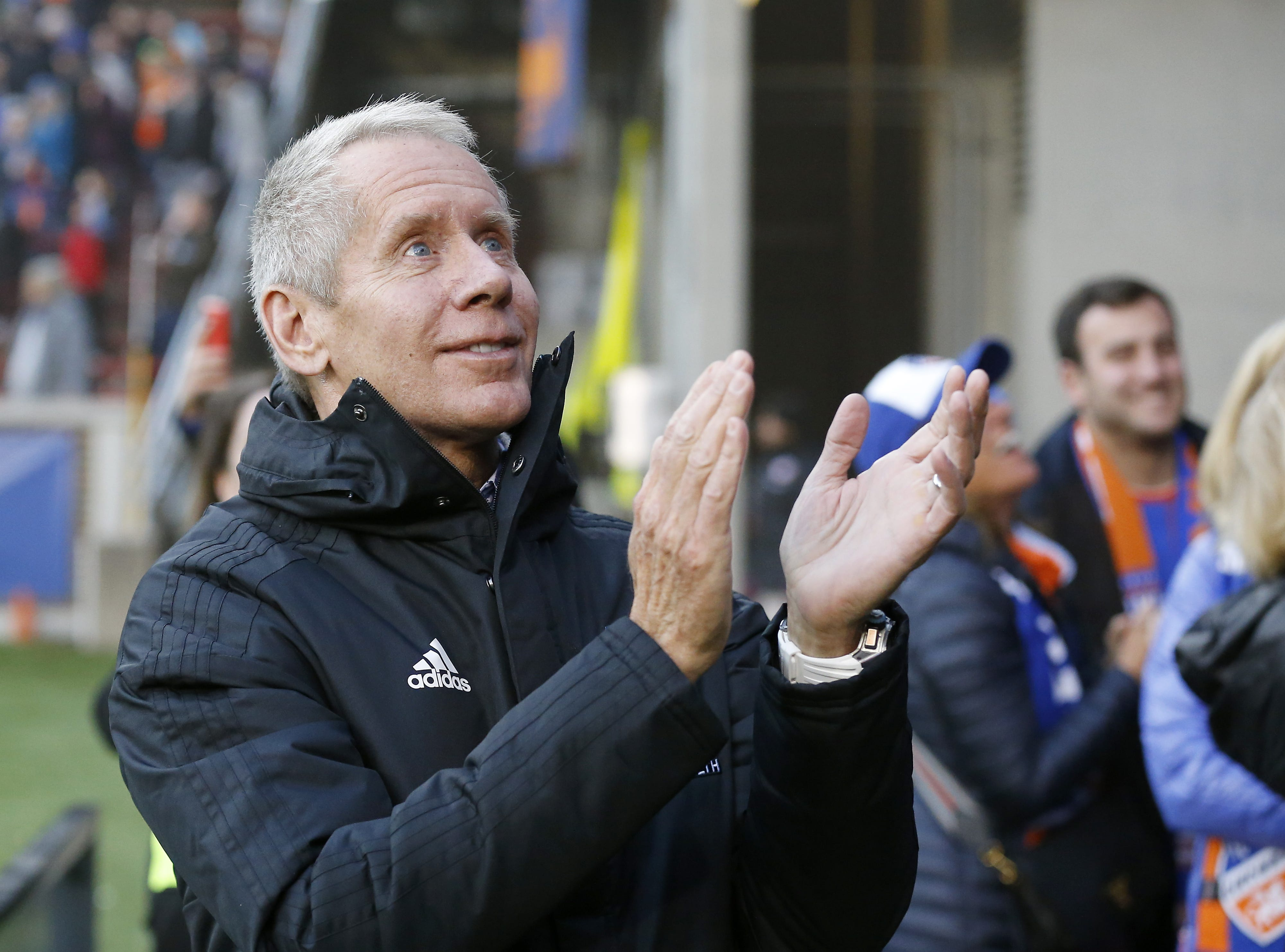 FC Cincinnati owner Carl Lindner applauds fans in the Bailey as it celebrates a win after the MLS match between FC Cincinnati and the Portland Timbers at Nippert Stadium in Cincinnati on Sunday, March 17, 2019. FC Cincinnati won its first home game as an MLS team, 3-0.