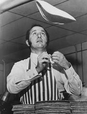 Buddy LaRosa, circa 1976, tossing pizza dough at his pizzeria.