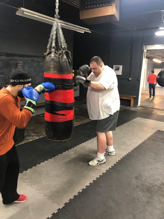 Matt Wahlert, right, during a recent workout