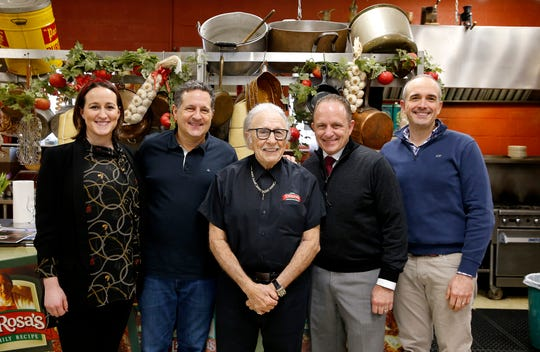 Buddy LaRosa, center, stands with, from left, granddaughter Christina LaRosa, his sons, Mark LaRosa, Michael LaRosa, and grandson Nick LaRosa.