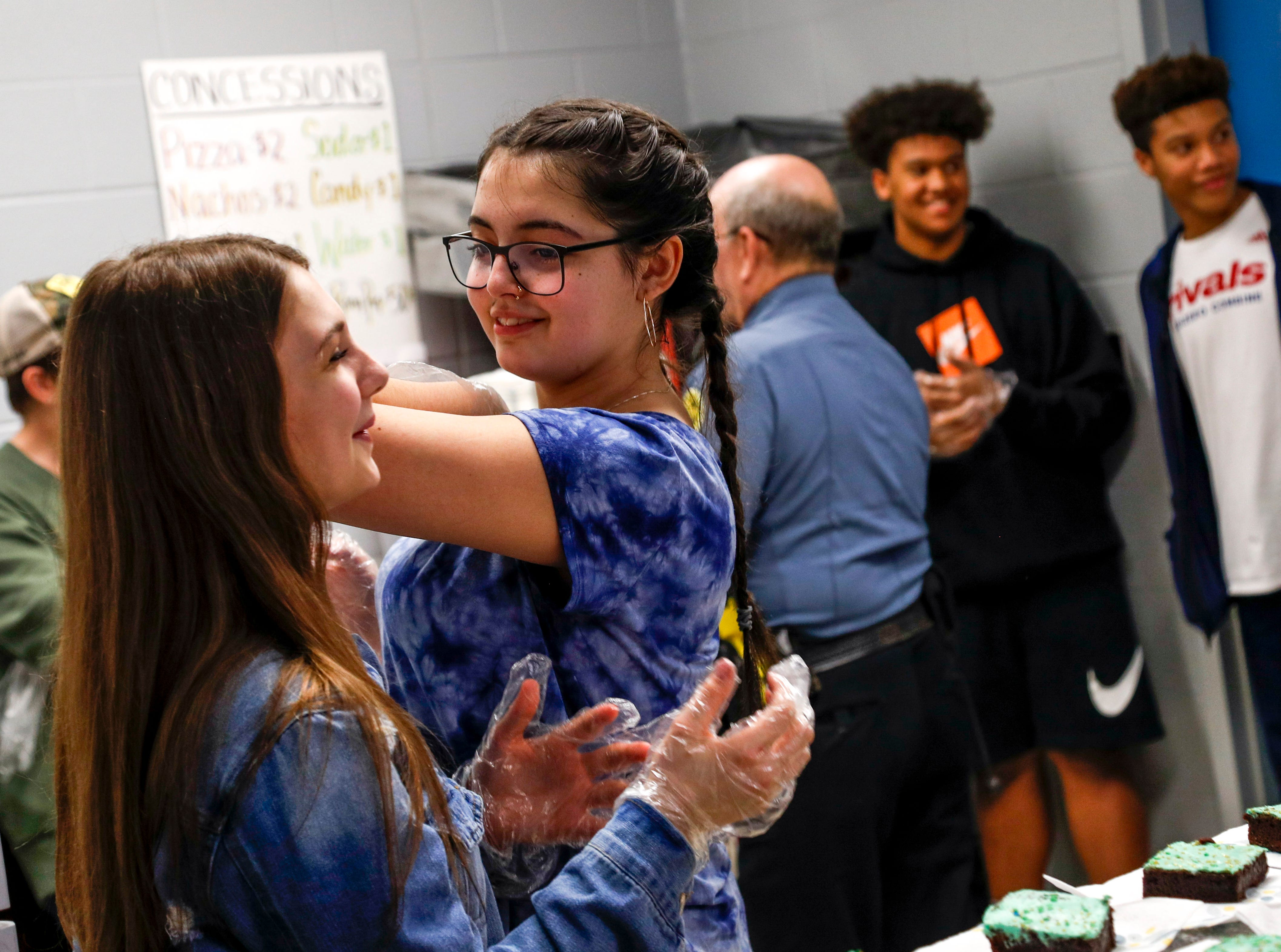 Student helpers chat before the start of the bake sale that will sell over 1200 brownies and profits will go towards the 8th grade dance at Richview Middle School in Clarksville, Tenn., on Friday, March 15, 2019.