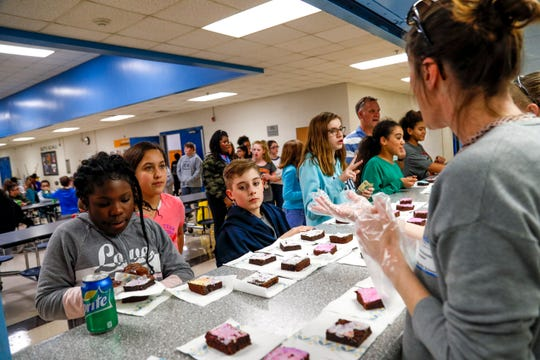 Students line the counter to purchase brownies at the last bake sale put on and fully supplied by SRO Richard Brown which money made from it will go towards funding the 8th grade dance at Richview Middle School in Clarksville, Tenn., on Friday, March 15, 2019.