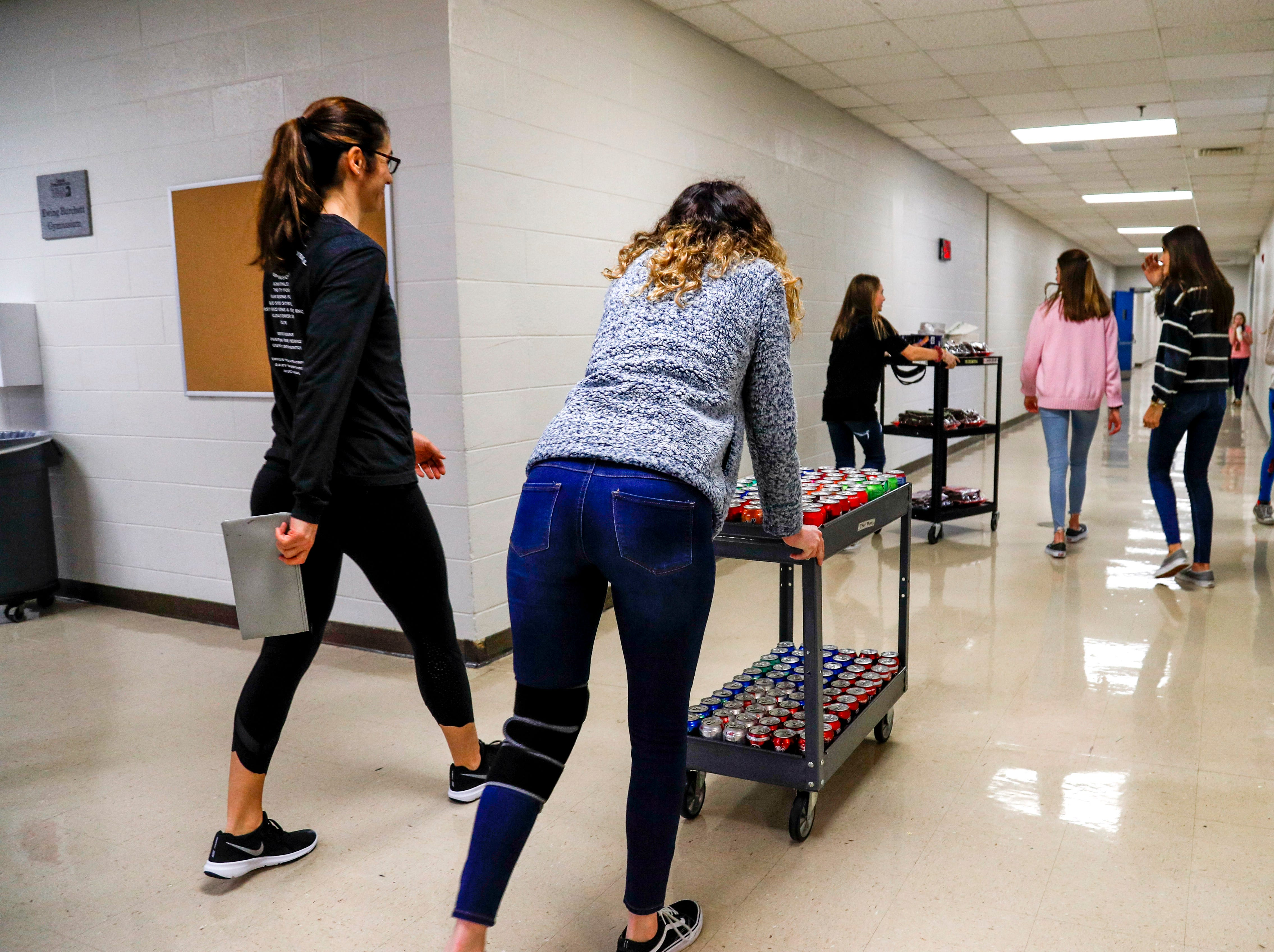 Students head down the halls with trays of brownies and drinks that will be sold as a part of the last bake sale and be donated to fund the 8th grade dance at Richview Middle School in Clarksville, Tenn., on Friday, March 15, 2019.