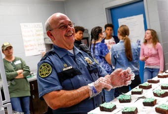 SRO Richard Brown holds his last bake sale at Richview Middle School, where for over five years he has helped raise money for school programs and activities by selling brownies.