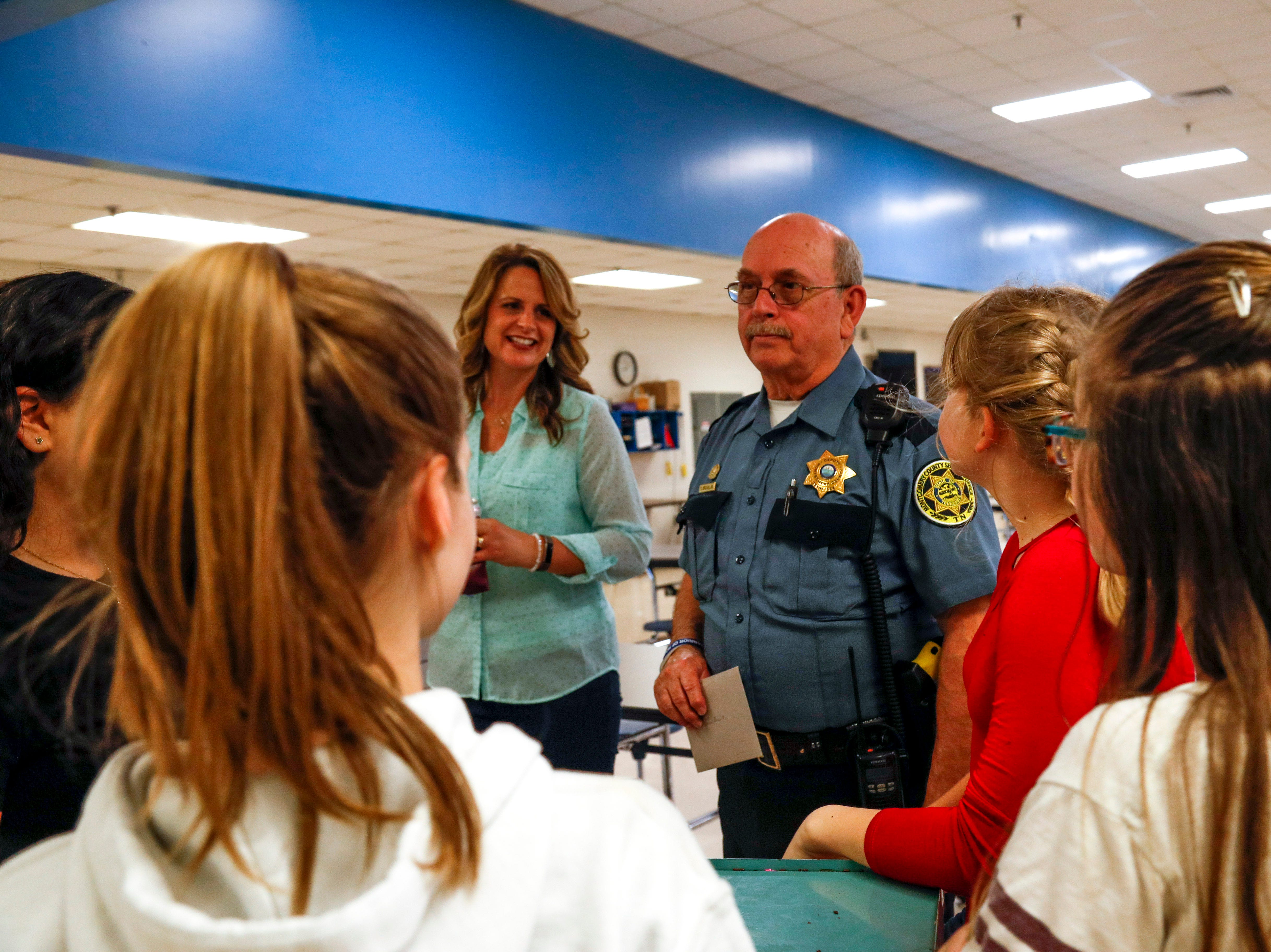 SRO Richard Brown speaks with 6th graders that had helped him for nearly six months at various bake sales at Richview Middle School in Clarksville, Tenn., on Friday, March 15, 2019.