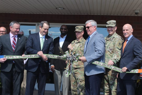 Brig. Gen. Todd Royar cuts the ribbon on the new American Job Center. Officials from Fort Campbell and surrounding communities took part in the grand opening Monday.