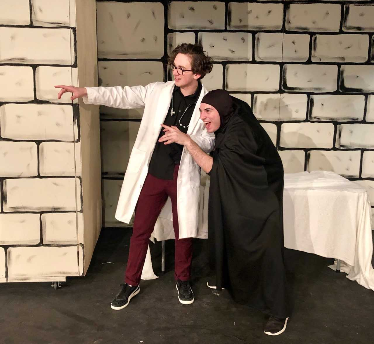 "Colin Hankenson, who portrays Dr. Frederick Frankenstein, and Nick Najarian as Igor rehearse a scene from Old Bridge High School's upcoming musical ""Young Frankenstein""."