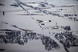 """Iowa Gov. Kim Reynolds toured counties hit by recent flooding in western Iowa on Monday, calling the extent of the damage """"unbelievable."""""""