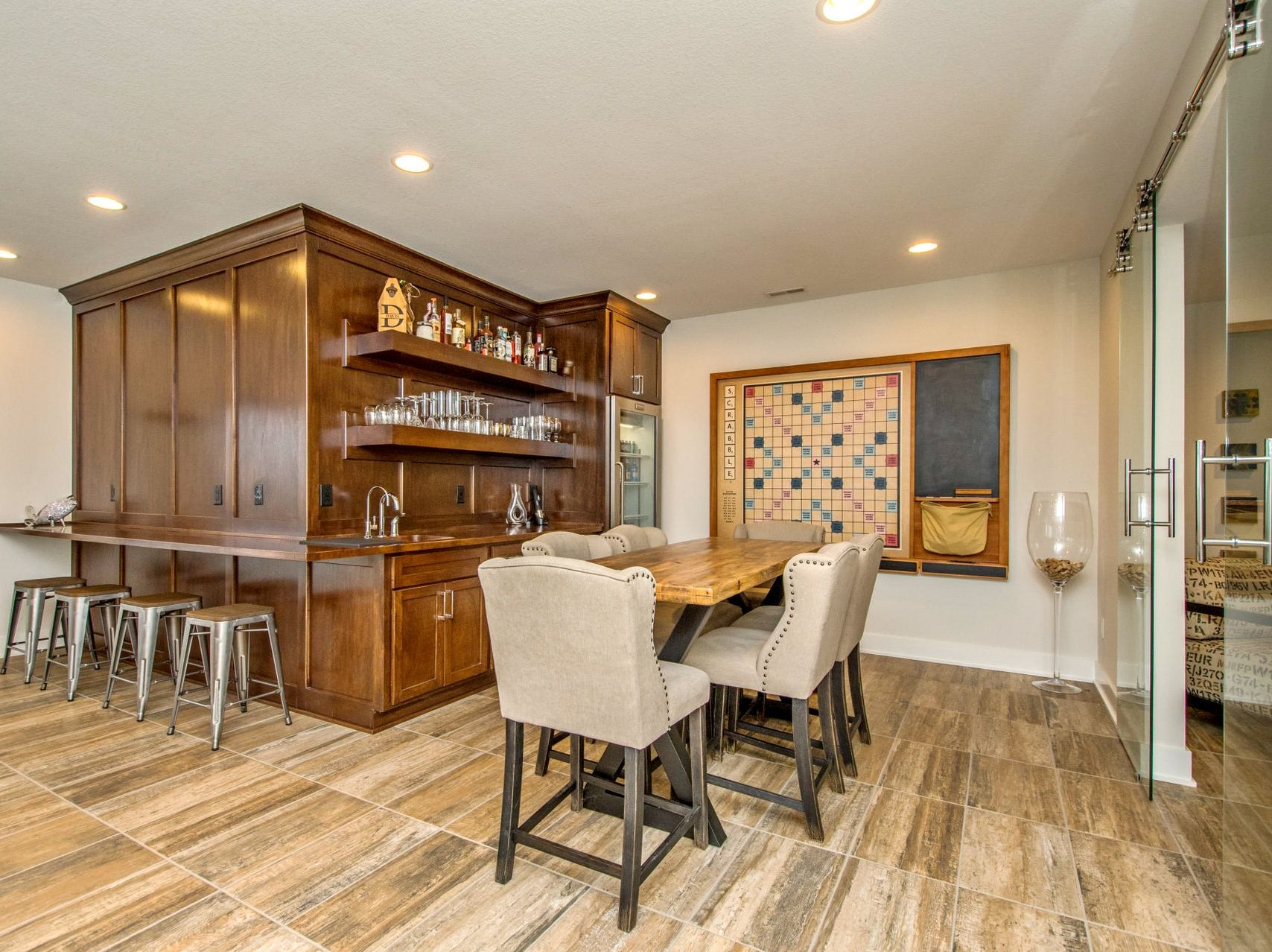 This immaculate executive home is located in the Timber Ridge Estates development in Van Meter, just minutes west of the Des Moines metro.