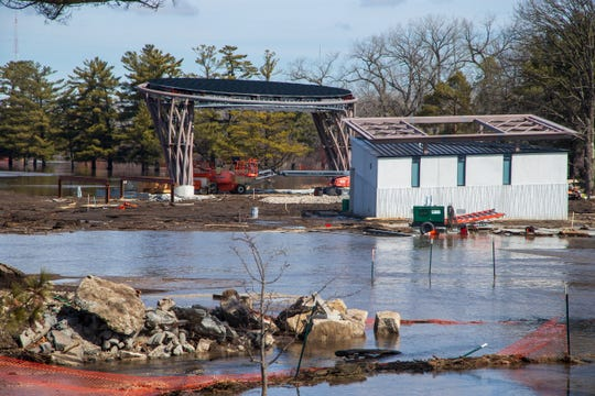 The Lauridsen Amphitheater, which is under construction and set to open in June, photographed Monday, March 18, 2019. It has been surrounded by water for a few days as substantial rainfall and fast-melting snowpack has caused nearby Raccoon River to top its banks.