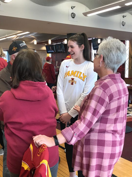 Iowa State star Bridget Carleton chats with fans during the team's Selection Monday party.