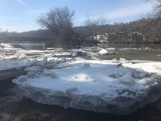 Chunks of ice sit next to the Des Moines River in Lehigh.