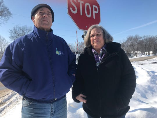 Wayne and Rita Brasel live near Avon Lake between Des Moines and Carlisle where idling trains block the only access to their neighborhood for hour at a time while workers load and unload wind blades and turbine parts.