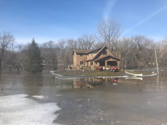 The Johnson family's house on River Street in Lehigh, Iowa, nearly sat on its own island Monday after weekend flooding.