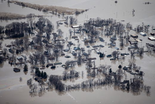 The entire city of Pacific Junction is underwater as floodwater from the Missouri and Platte Rivers inundate the town, on Monday, March 18, 2019, in Mills County. The city was evacuated overnight as the water continued to rise.