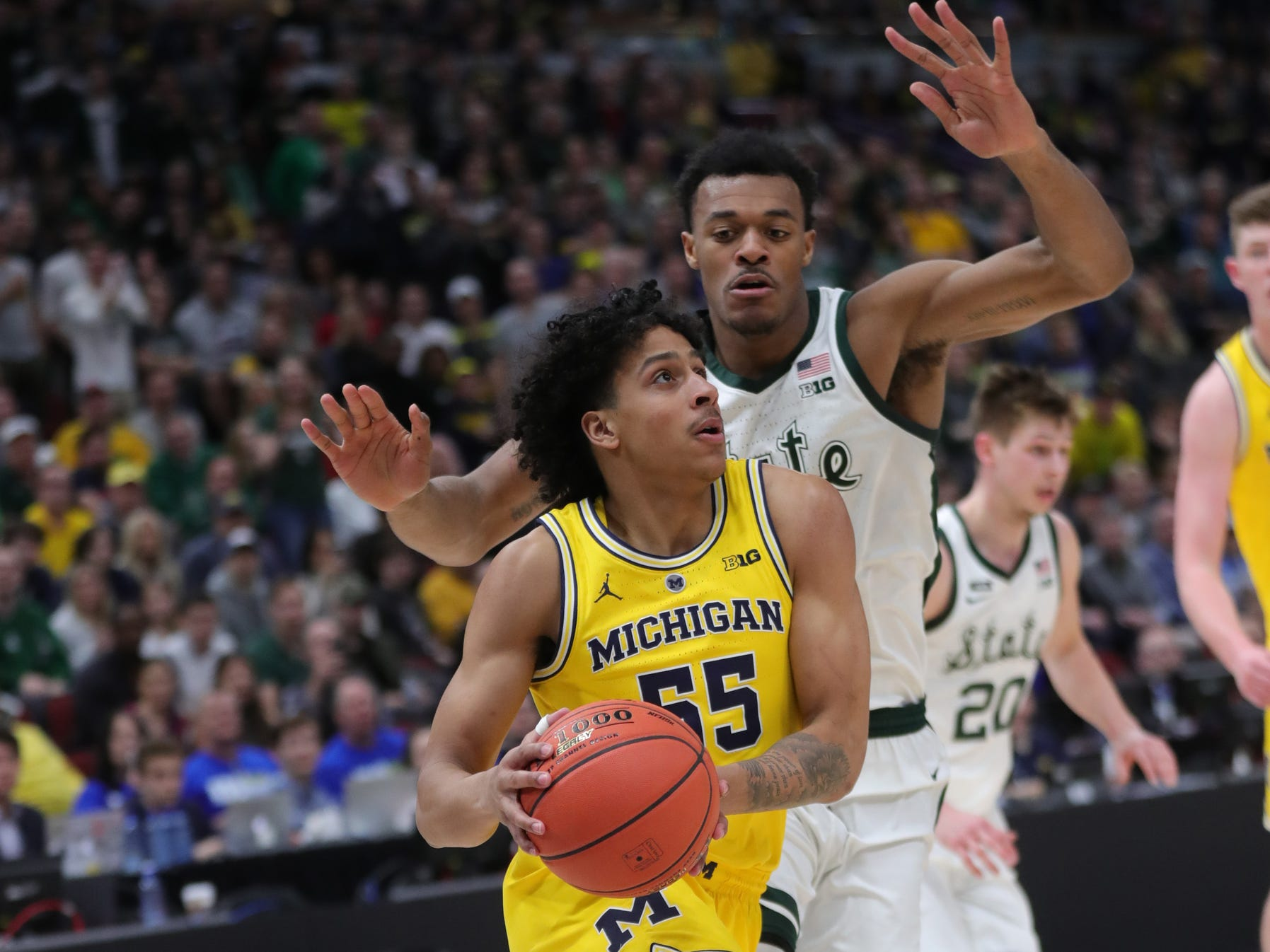 Michigan State's Xavier Tillman defends Michigan's Eli Brooks during the Big Ten tournament championship Sunday, March 17, 2019 in Chicago.
