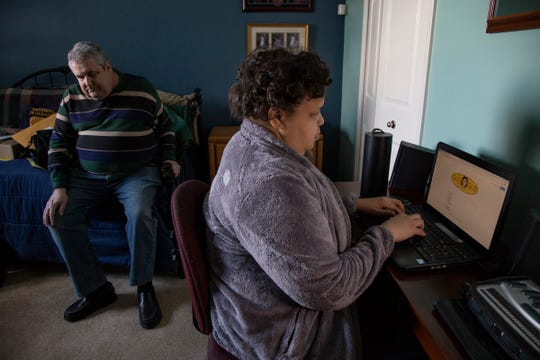 State president of National Federation of the Blind Mike Powell, 65, left, and his friend Sabrina Simmons, 46, who is the Detroit president chapter of National Federation of the blind, demonstrate some accessibility issues websites have for navigating for the visually impaired.