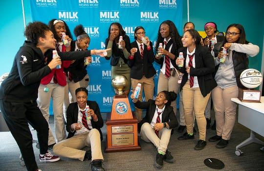 Rickea Jackson, center, and her teammates from Detroit Edison had some fun slurping down some milk from the official sponsor after she was  named the 2019 Miss Basketball Monday, March 18, 2019 at the Detroit Free Press.