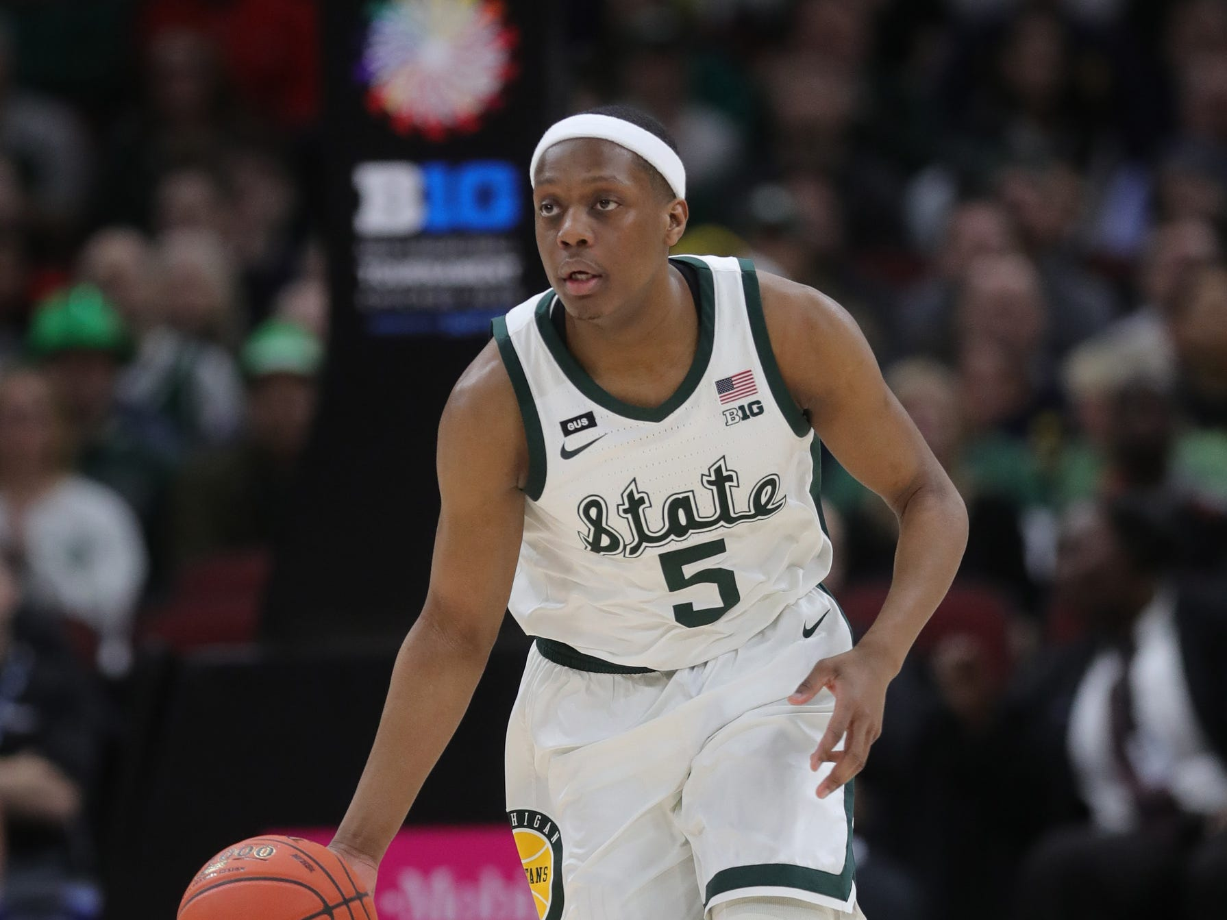 Michigan State's Cassius Winston brings the ball up court during the first half against Michigan in the Big Ten tournament championship Sunday, March 17, 2019 in Chicago.