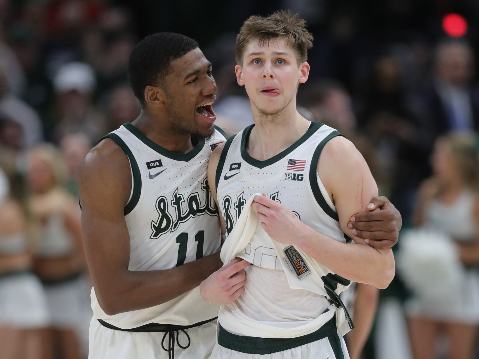 Michigan State's Aaron Henry, left, and Matt McQuaid celebrate the 65-60 win against Michigan in the Big Ten tournament championship Sunday, March 17, 2019 in Chicago.
