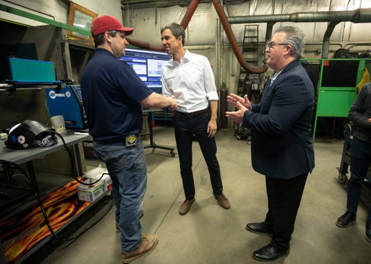 Welding instructor Chris Briggs, left, shakes hands with democratic presidential candidate Beto O'Rourke of Texas as Michigan Regional Council of Carpenters president Tom Lutz stands at right while O'Rourke tours the Carpenters Training Center in Ferndale Monday, March 18, 2019.