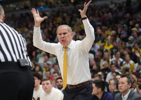 Michigan coach John Beilein argues a call during the Big Ten tournament championship against Michigan State, Sunday, March 17, 2019 in Chicago.