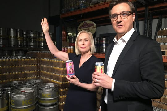 U.S. senator of New York Kirsten Gillibrand waves after trying a Warrior Princess Grapefruit beer at Rochester Mills Production Brewery after taping a town hall forum with MSNBC host Chris Hayes on Monday, March 18, 2019.