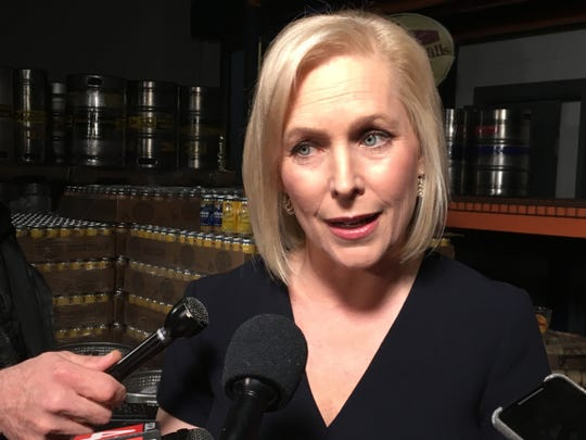 U.S. senator of New York Kirsten Gillibrand answers questions from the press at Rochester Mills Production Brewery after taping a town hall forum with MSNBC host Chris Hayes on Monday, March 18, 2019.