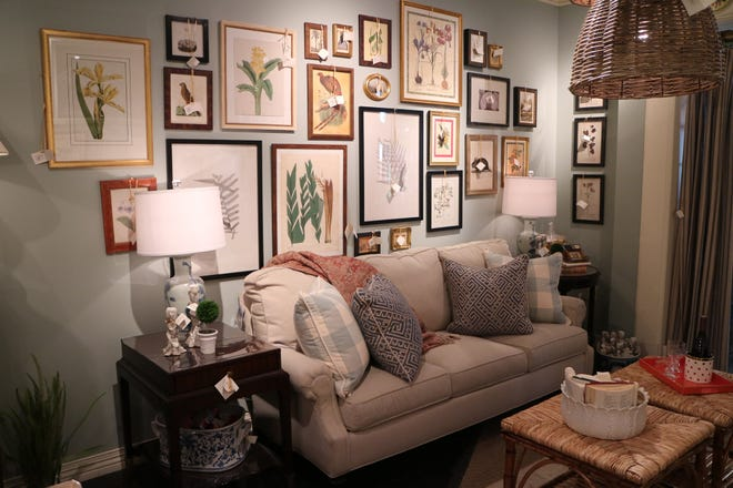 A gallery wall is a great way to display multiple pieces of art when you can't pick a favorite. Mix in different frames, sizes and textures to create a fun and interesting design. (Handout/TNS)