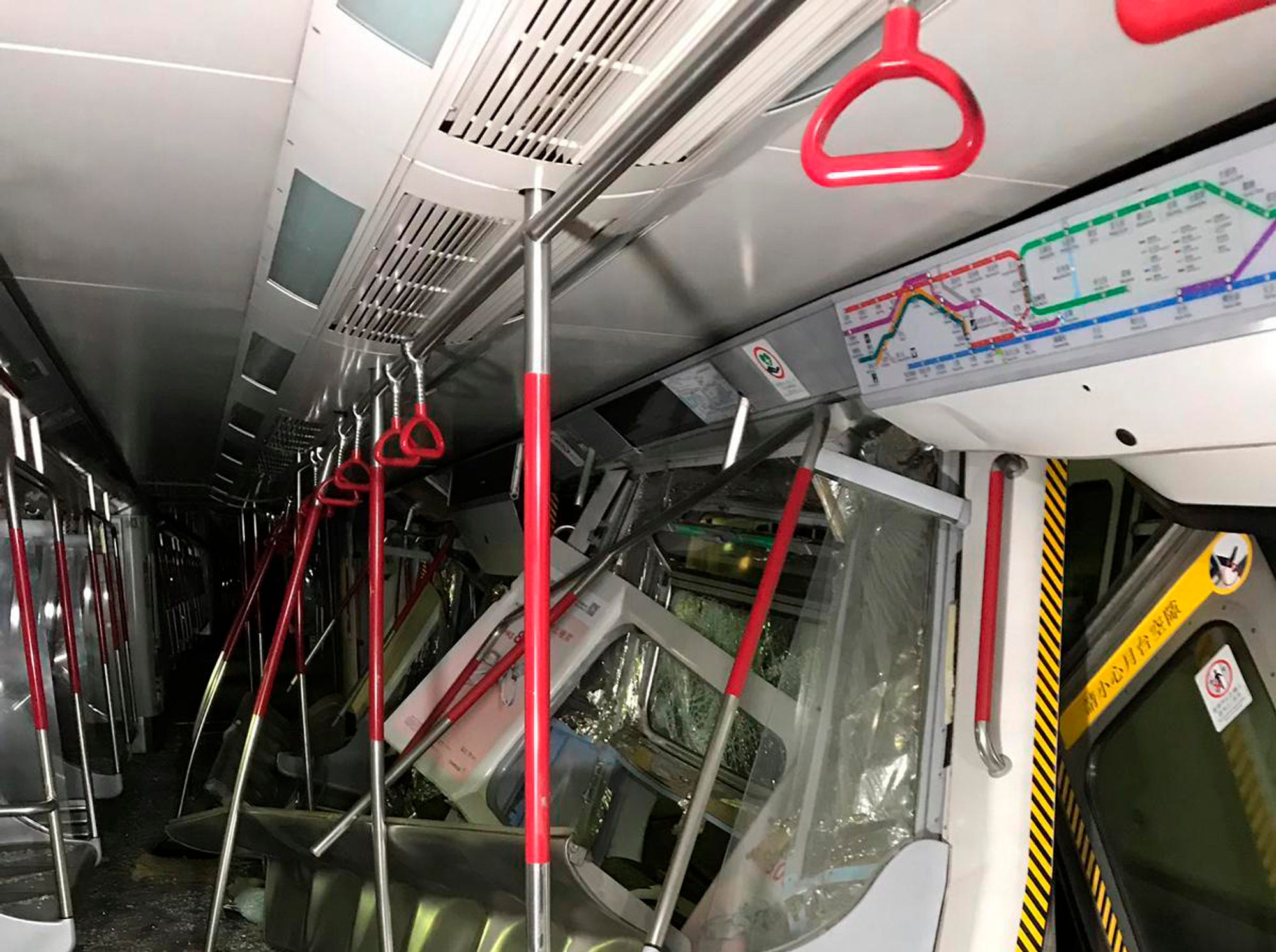 In this Monday, March, 18, 2019 photo released by MTR Corporation, two MTR trains are seen after the collision in the morning on the Tsuen Wan Line during testing of the the rail company's new signaling system in Hong Kong. Two drivers suffered minor injuries and were taken to hospital.