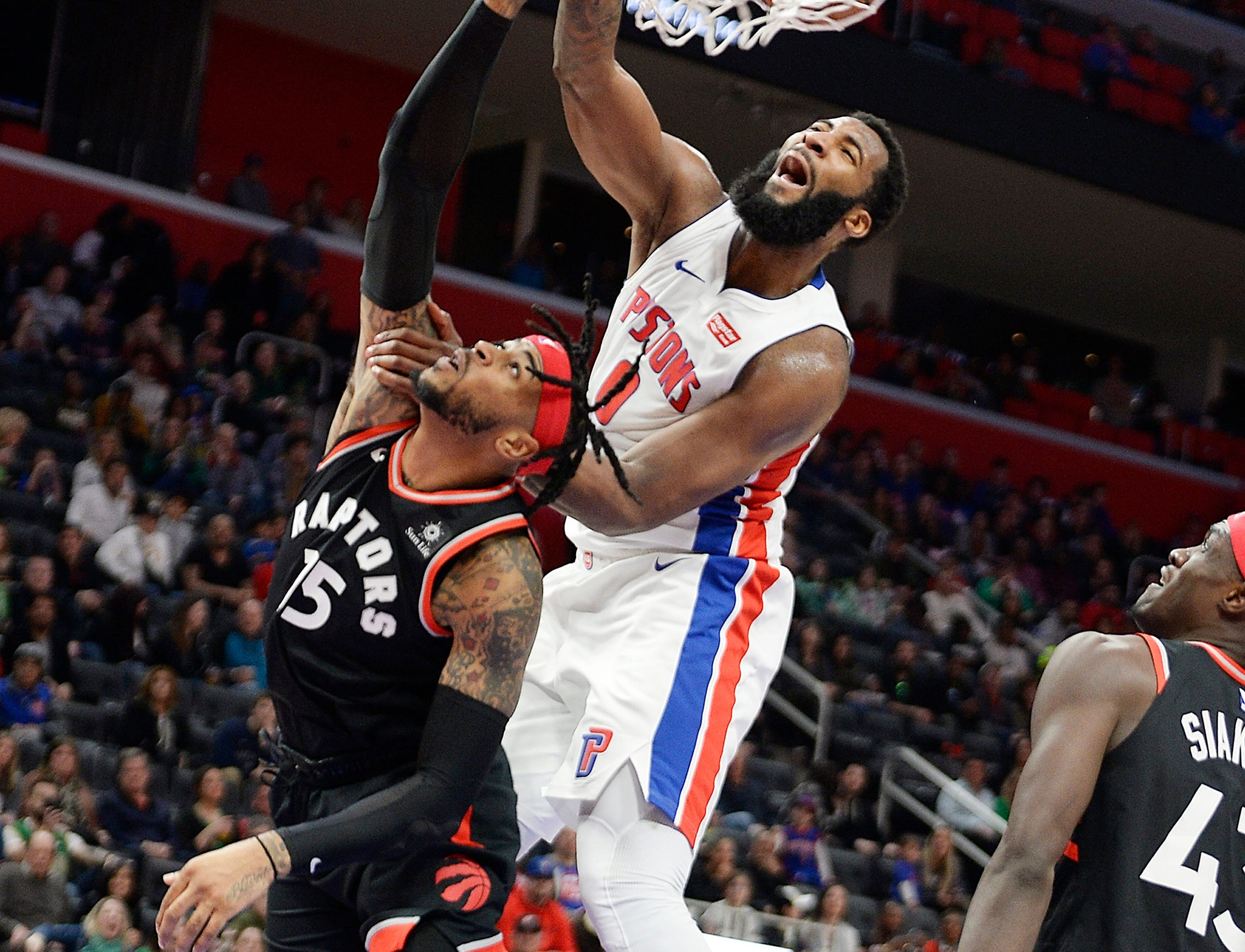 Pistons' Andre Drummond dunks over Raptors' Eric Moreland in the third quarter, Drummond had 15 points and 17 rebounds. The Pistons defeated the Raptors 110-107, Sunday, March 17, 2019 at Little Caesars Arena in Detroit, Michigan.